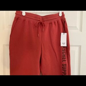 HERSCHEL SHERPA RED TRACK PANTS - Size small